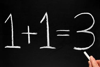 Writing 1+1=3 on a blackboard.