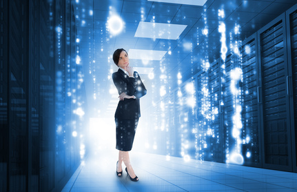 Businesswoman standing and looking thoughtful in data centerBusinesswoman with glowing matrix