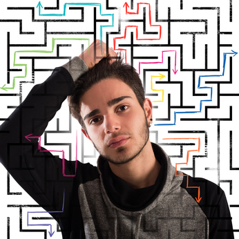 Boy with thoughtful expression with maze background