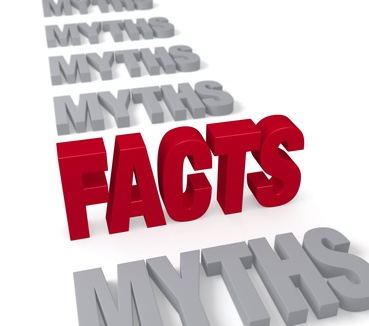 "In a long row of plain gray ""MYTHS"", a bold, bright red ""FACTS"" stands tall, dominating the foreground.  Focus is on ""FACTS."" Isolated on white."