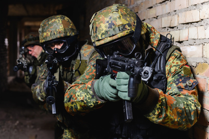 Group of elite police marksmen with weapon in building during a special operation